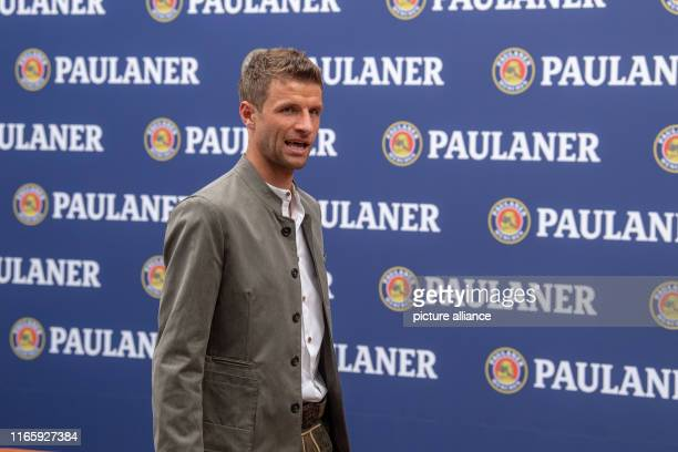 September 2019, Bavaria, Munich: Thomas Müller, player of FC Bayern, walks along a sponsor wall. The players and the coach of FC Bayern Munich...