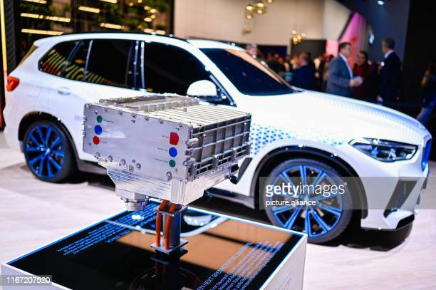 September 2019, Hessen, Frankfurt/Main: The model of a fuel cell will be on display at the IAA at the BMW stand in front of a BWM iHydrogen Fuel...