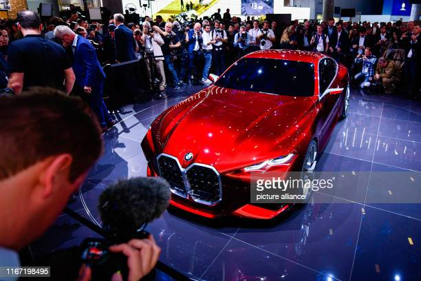 September 2019, Hessen, Frankfurt/Main: The new car model BMW Concept 4 will be presented at the IAA after a press conference at the booth of the car...