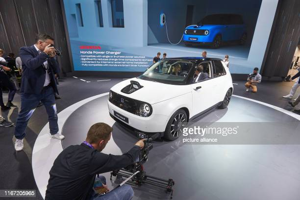 September 2019, Hessen, Frankfurt/Main: The small electric car Honda e will be presented at the stand of the Japanese car manufacturer Honda at the...