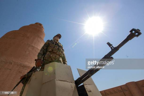 A member of the Peace Companies an Iraqi armed group linked to Iraq's Shia community and part of the Iraqi statesponsored Popular Mobilization Forces...