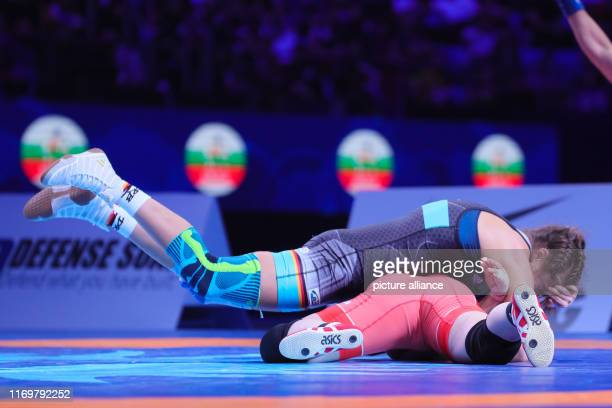 September 2019, Kazakhstan, Nur Sultan: Wrestling: World Championship, 68 kg/freestyle, women, fight for 3rd place Anna Schell from Germany and Sara...
