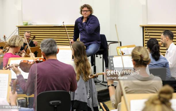 September 2019, Mecklenburg-Western Pomerania, Rostock: Marcus Bosch , artistic director of the Norddeutsche Philharmonie, stands before a rehearsal...