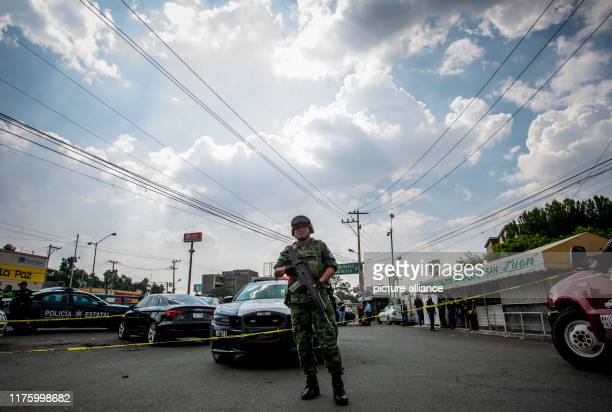 September 2019, Mexico, Los Reyes la Paz: A member of the Mexican National Guard works at the scene of the murder of a man in the state of Mexico....