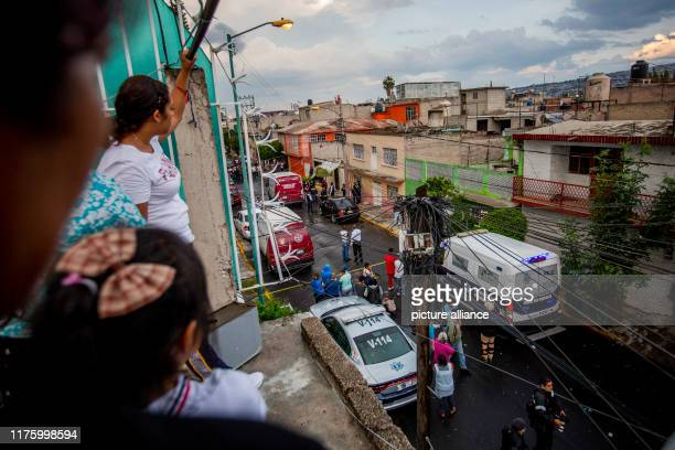 17 September 2019 Mexico Nezahualcoyotl Neighbours in the community of Nezahualcoyotl look at the place where a man was shot in front of his house...