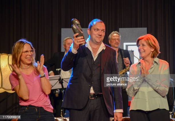 21 September 2019 RhinelandPalatinate Daun Actress Anneke Kim Sarnau and actor Charly Hübner are happy about the thriller award Roland which they...