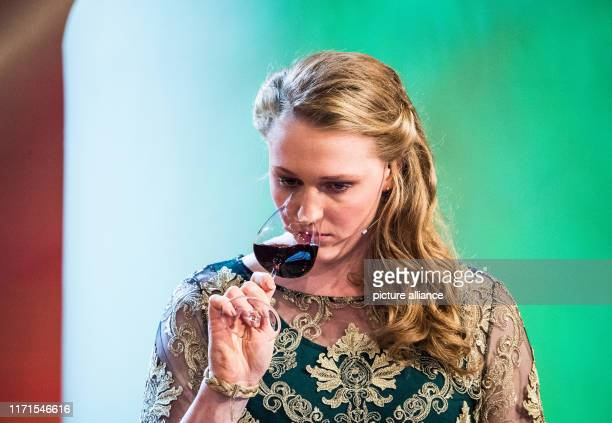 September 2019, Rhineland-Palatinate, Neustadt an der Weinstraße: The applicant Laura Gerhardt, Mosel wine queen of the region, uses the wine glass...