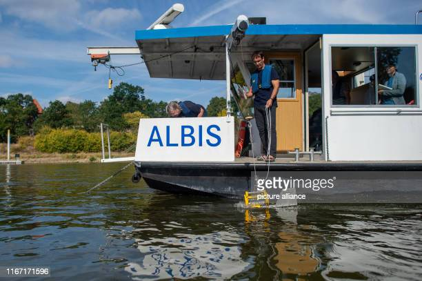 04 September 2019 SaxonyAnhalt Magdeburg The scientist Norbert Kamjunke from the Helmholtz Centre for Environmental Research has the research vessel...