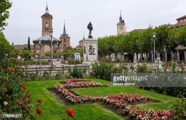 21 September 2019 Spain Alcala De Henares The sculpture of the Spanish national poet Miguel de Cervantes on the market square in the historic centre...