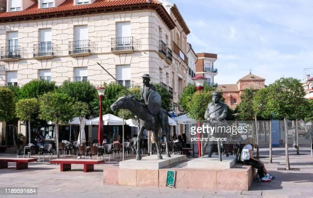 23 September 2019 Spain Alcazar De San Juan A sculpture by Don Quixote and Sancho Panza on the market square The region served Miguel de Cervantes as...