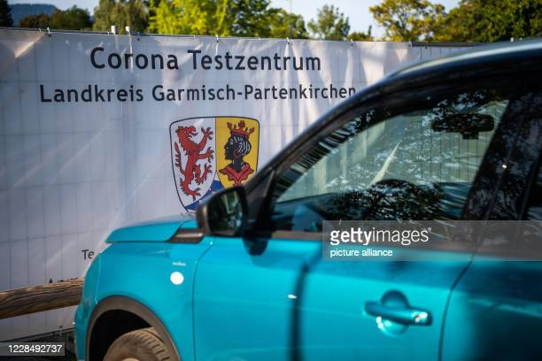 13 September 2020 Bavaria GarmischPartenkirchen A white construction fence with the inscription Corona Testzentrum Landkreis GarmischPartenkirchen...