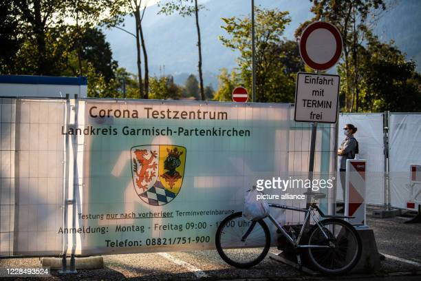 13 September 2020 Bavaria GarmischPartenkirchen One person is standing in front of the Corona test centre of the city After a violent corona outbreak...