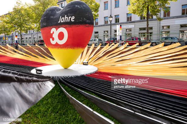 """September 2020, Brandenburg, Potsdam: A heart in the colours of the German flag with the inscription """"30 years"""" stands at the """"Einheits-Expo"""" on the..."""