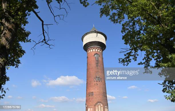 September 2020, Brandenburg, Wustermark/Ot Elstal: The historic water tower on the construction site of the future Bahn Technologie Campus Havelland...