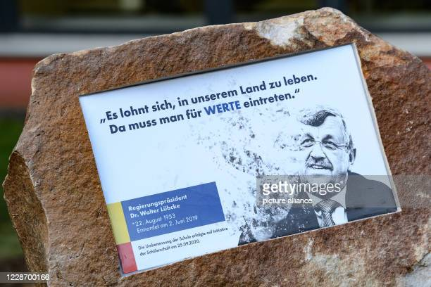 A memorial stone with the inscription It is worthwhile to live in our country Da muss mann für Werte eintreten was unveiled at the ceremony to mark...