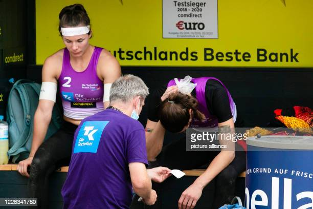 September 2020, Schleswig-Holstein, Timmendorfer Strand: Beach volleyball: German championships: Anna-Lena Grüne is sitting on the players bench,...