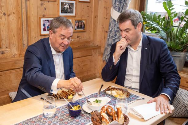 DEU: Soeder And Laschet Eat Franconian Sausage