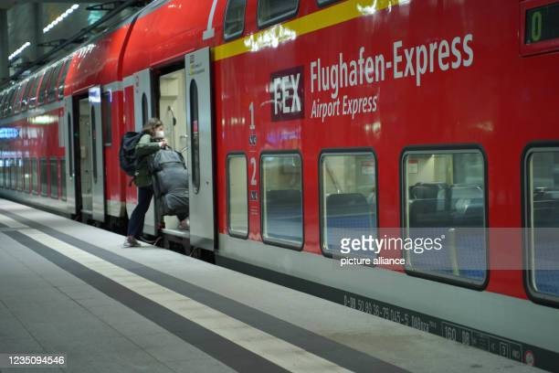 September 2021, Berlin: A passenger boards the airport express on platform 5 at Berlin Central Station. Since 2 o'clock, the nationwide strike of the...