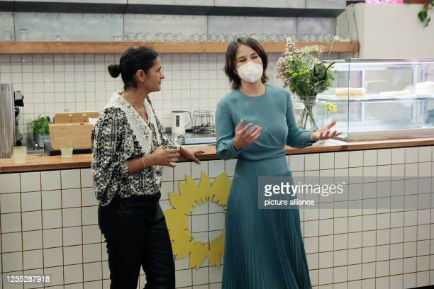 September 2021, Berlin: Annalena Baerbock , federal chairwoman and candidate for chancellor, talks with Leyla Piedayesh, entrepreneur, at a meeting...