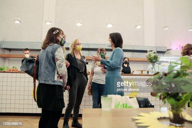 September 2021, Berlin: Annalena Baerbock , federal chairwoman and candidate for chancellor, speaks with guests at a meeting with influential women...