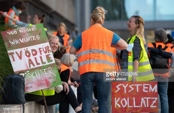 September 2021, Berlin: Participants in a demonstration of employees of the state-owned Berlin hospitals Vivantes and Charité stand in front of the...