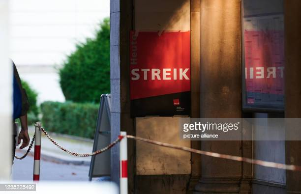 """September 2021, Berlin: """"Strike"""" is written on the poster hanging at the main entrance of the hospital """"Charite Campus Virchow-Klinikum"""". The strike..."""