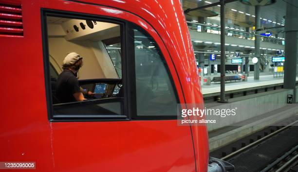 September 2021, Berlin: The driver of an airport express train prepares for his journey at the main station. Since 2 o'clock, the nationwide strike...