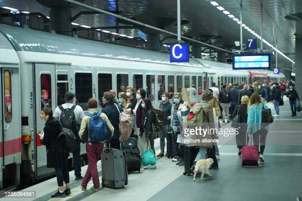 September 2021, Berlin: Travellers board the Intercity train to Hamm at the main station. Since 2 o'clock, the nationwide strike of the train...