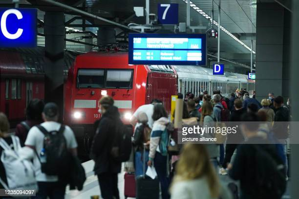 September 2021, Berlin: Travellers wait at Berlin central station for the Intercity train to Hamm to arrive. Since 2 o'clock, the nationwide strike...
