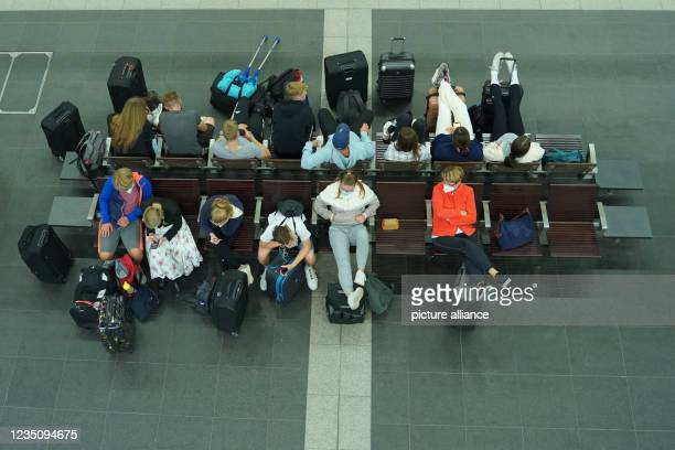 September 2021, Berlin: Travellers wait for their train at Berlin central station. Since 2 o'clock, the nationwide strike of the train drivers' union...