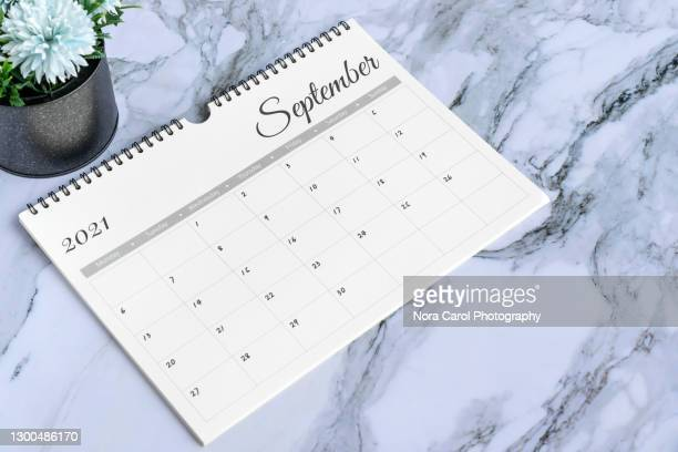 september 2021 calendar on top of marble desk - september stock pictures, royalty-free photos & images