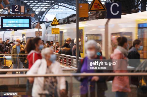 September 2021, North Rhine-Westphalia, Cologne: A train leaves the main station. The German Train Drivers' Union ended its strike at Deutsche Bahn...