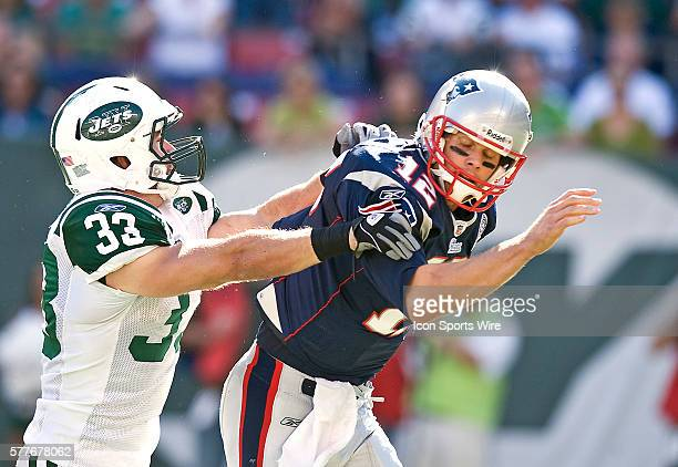 New England Patriots Vs New York Jets at Giants Stadium NE Patriots quarterback Tom Brady scrambles in the pocket after releasing the ball late in...
