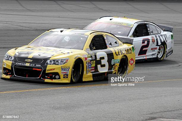 Austin Dillon leads Brad Keselowski through turn 2 during the running of Sprint Cup Series Sylvania 300 at New Hampshire Motor Speedway in Loudon, NH.