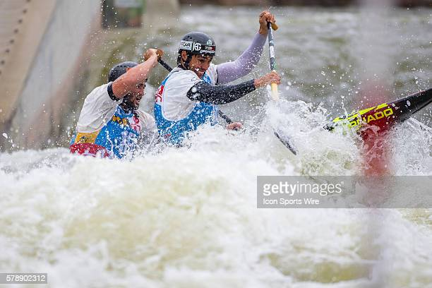 Daniel Marzo and Jesus Perez compete in the men's double canoe finals at the Deep Creek 2014 whitewater slalom World Championships at Adventure...