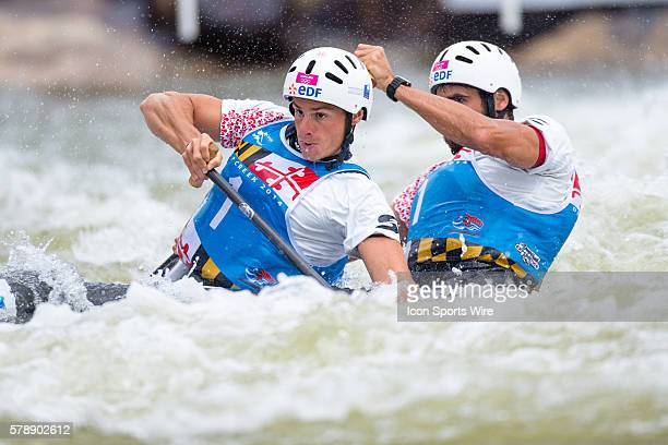 Klauss Gauthier and Matthieu Peche compete in the men's double canoe finals at the Deep Creek 2014 whitewater slalom World Championships at Adventure...