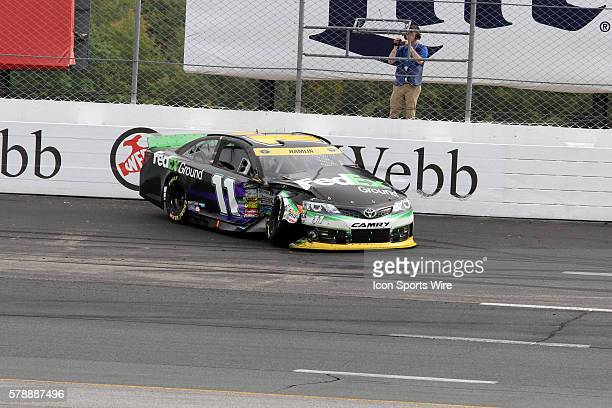 Chase contender, Denny Hamlin, driver of the FedEx Ground Toyota wrecks during the running of Sprint Cup Series Sylvania 300 at New Hampshire Motor...