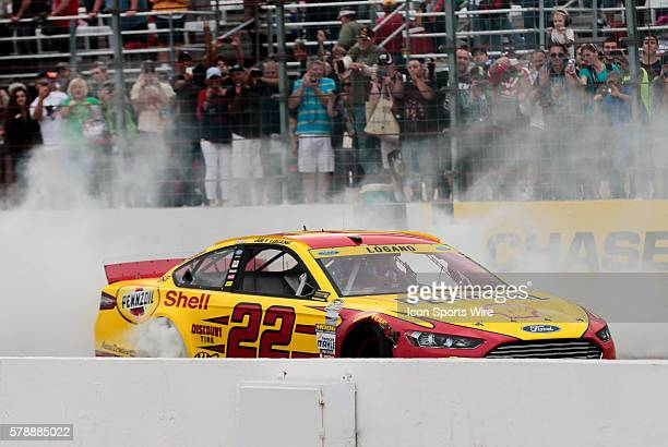 NASCAR Chase contender Joey Logano driver of the Shell/Pennzoil Ford burns rubber after winning the Sylvania 300 at New Hampshire Motor Speedway in...