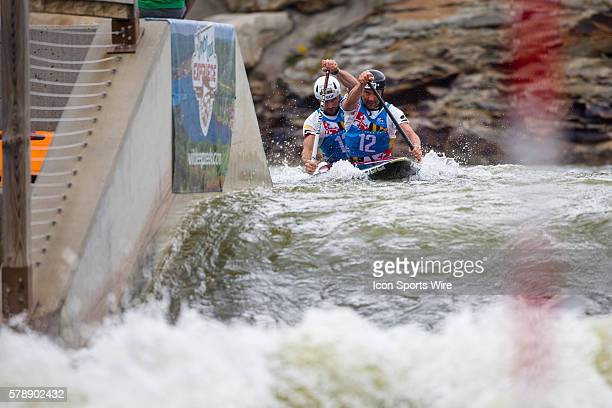 Pierre Labarelle and Nicholas Peschier competes in the men's double canoe finals at the Deep Creek 2014 whitewater slalom World Championships at...