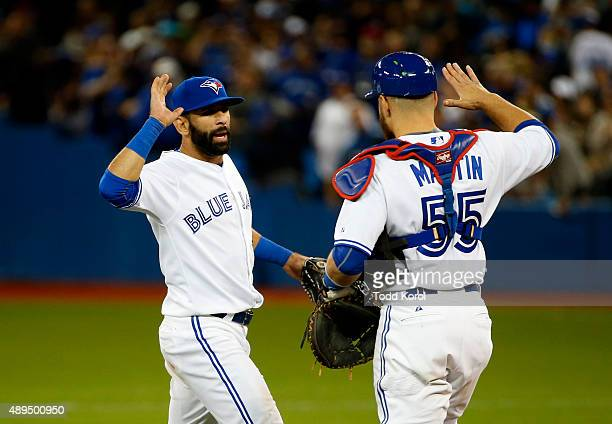 TORONTO ON September 21 2015 Toronto Blue Jays right fielder Jose Bautista and catcher Russell Martin celebrate their win during their American...