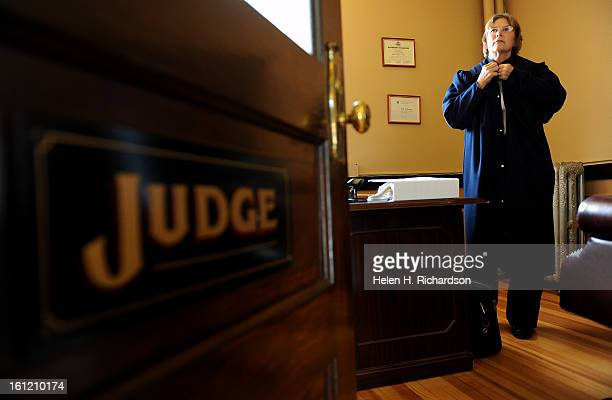 WALDEN CO September 22 2011 Judge Cindy Wilson puts on her judicial robe before heading into court for the morning's session There are a handful of...