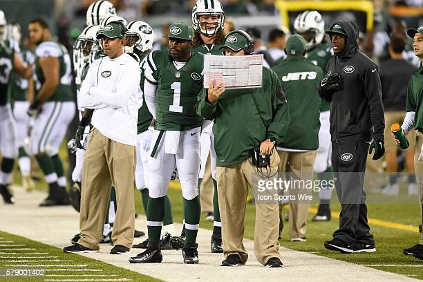 New York Jets offensive coordinator Marty Mornhinweg and New York Jets quarterback Michael Vick during a NFL game between the Chicago Bears and the...