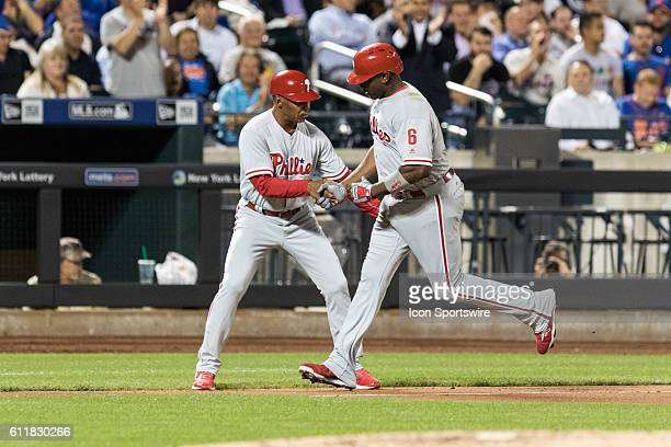 Philadelphia Phillies First base Ryan Howard [3800] is congratulated by third base coach Juan Samuel after hitting a solo home run in the fifth...