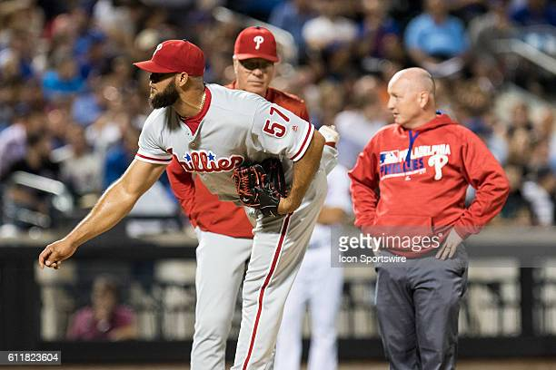 Philadelphia Phillies Pitcher Luis Garcia [9007] throws as manager Peter Mackanin and trainer Scott Sheridan look on after Garcia was hit by a batted...