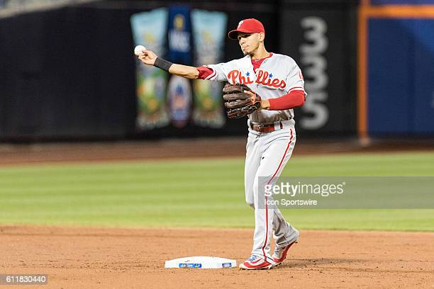 Philadelphia Phillies Second base Cesar Hernandez [8497] completes a double play throwing out New York Mets Shortstop Asdrubal Cabrera [6195] in the...