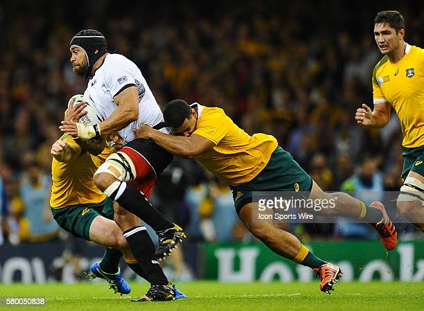 Fiji's Netani Talei is tackled by Australia's Scott Sio during the 2015 Rugby World cup match-up between Australia and Fiji being held at Millennium...