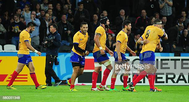 Romania's Valentin Ursache celebrates scoring his sides first try with team-mates during the 2015 Rugby World Cup match-up between France and Romania...