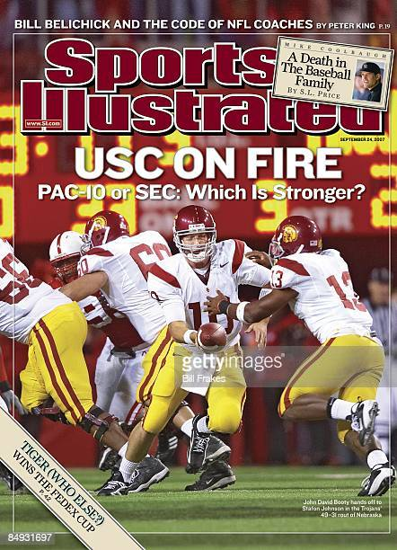 September 24 2007 Sports Illustrated via Getty Images Cover College Football USC QB John David Booty in action making handoff to Stafon Johnson...