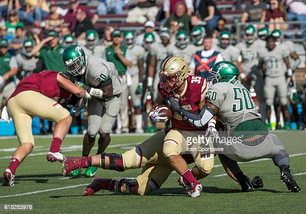 Boston College Eagles running back Tyler Rouse is tackled by Wagner Seahawks defensive lineman Jordan Baskerville during the second half of the game...