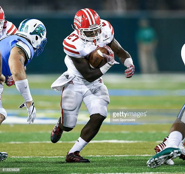 LouisianaLafayette Ragin Cajuns running back Raymond Calais runs through a hole in the line during the second half of the game between the Tulane and...